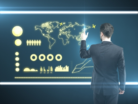 businessman pressing a touchscreen communication  button photo