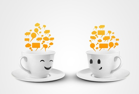 two happy cups smileys with speech bubbles photo