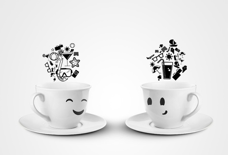 two happy cups dream travel on a white background photo