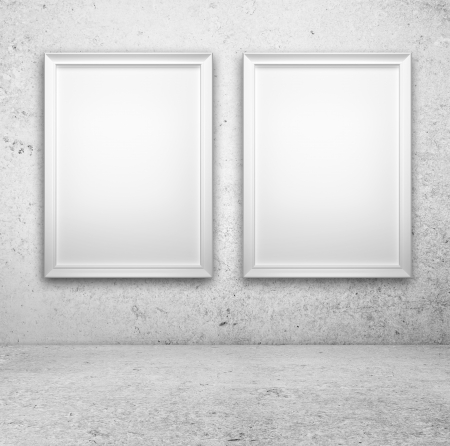 amaged: two blank frame on a concrete wall Stock Photo