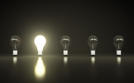 light bulbs stand in rows one glows Stock Photo - 14586964