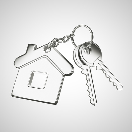 key in chain: key chain with key in form of home Stock Photo