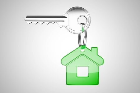 key with green key chain in form of home photo