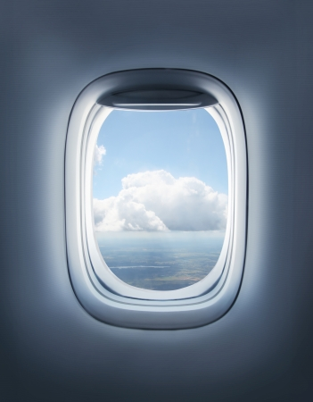 clouds in the aircraft's porthole photo
