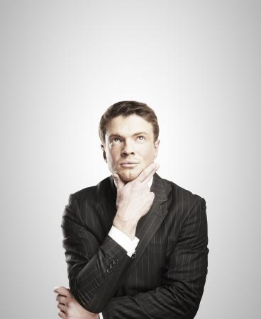 pensive businessman on white background photo