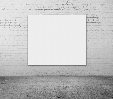 amaged: white blank frame on a brick wall