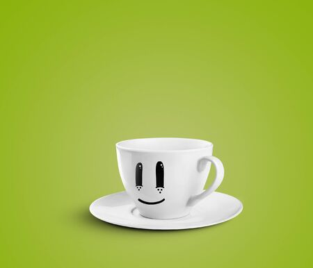 happy cup on a green background photo