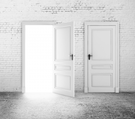 amaged: white brick room and two door Stock Photo