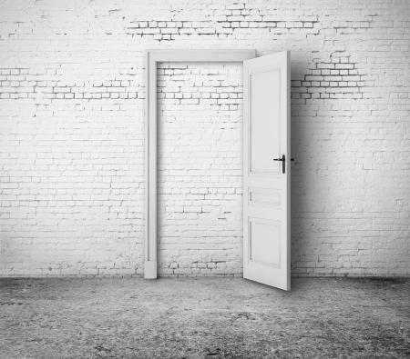 open door in white brick room photo