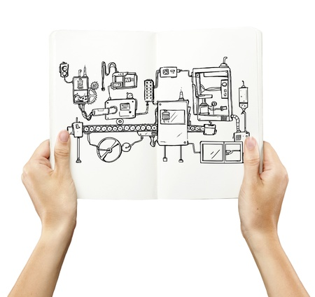 thumbnail: book in hand with drawing mechanism Stock Photo