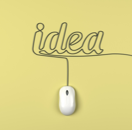 mouse and cables in form of idea on a yellow background photo