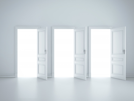 doors open: three open doors in white room Stock Photo