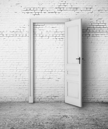 open door in white brick wall photo