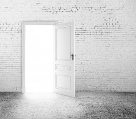 doors open: open door in white brick wall