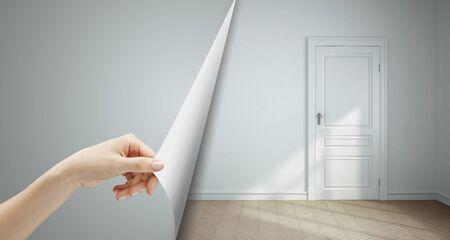 puerta abierta: la mano se convierte en el cuarto de página gris
