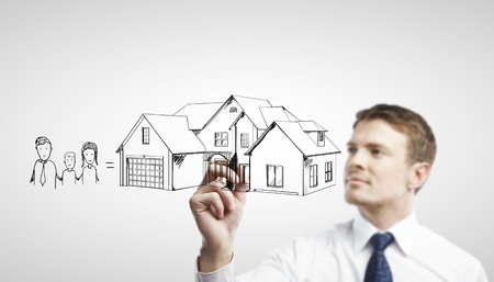 planificacion familiar: Casa empresario dibujo sobre un fondo blanco Foto de archivo