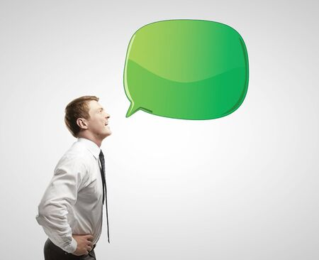 businessman with green speech bubble Stock Photo - 14748090