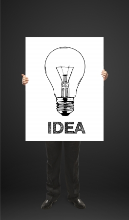 man holds a placard sold idea Stock Photo - 14768065