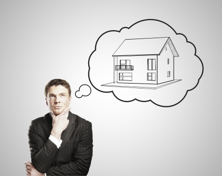 businessman thinks about a cottage Stock Photo - 14748094