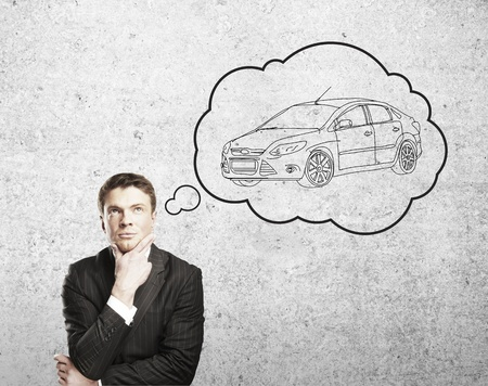 thinks: man thinks about a new  car Stock Photo