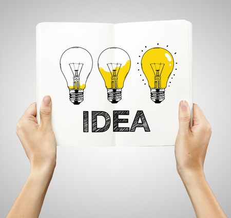 idea bulb: drawing three lamps in book on a white background Stock Photo