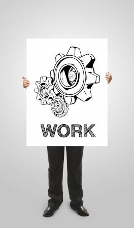 man holds poster  work concept  on a white background Stock Photo - 14765448