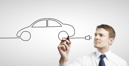 businessman drawing abstract model car photo