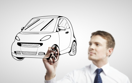 young man drawing abstract model car photo