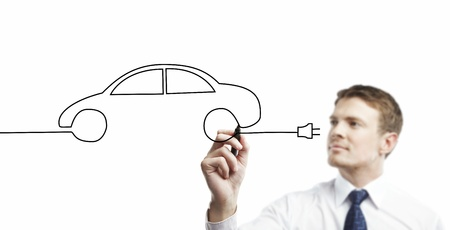 young businessman drawing abstract model car photo