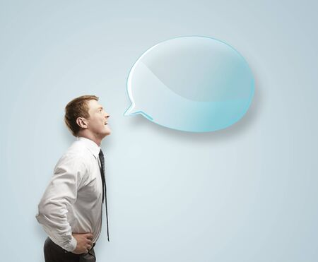 man with blue speech bubble photo