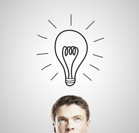 businessman with a drawing lamps over his head Stock Photo - 14768556