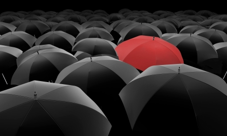 Red umbrella among black umbrellas photo