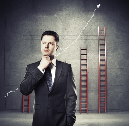businessman thinking on a ladder background photo