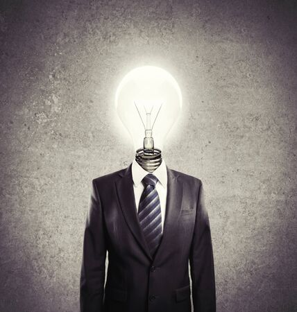 businessman with lamp-head on a white background photo