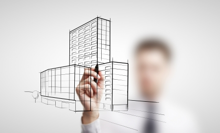 businessman drawing skyscrapers on a white background photo
