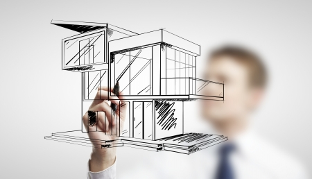 man drawing modern cottage on a white background photo