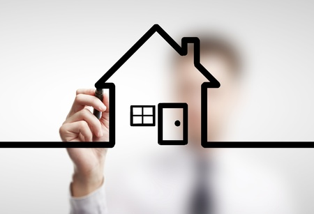 businessman drawing abstract  cottage on a white background photo