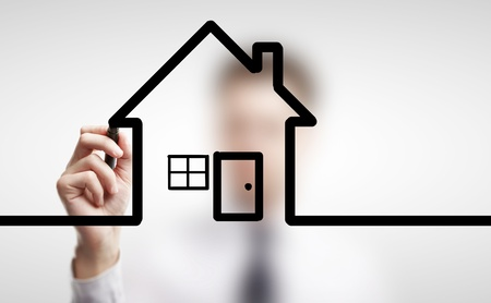 man drawing abstract  cottage on a white background photo