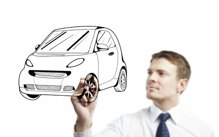 young man drawing abstract car photo