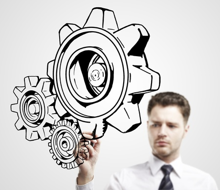 man drawing gears on a white background photo