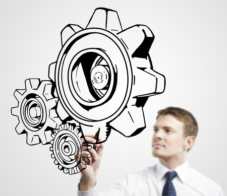 leadership abstract: businessman drawing gears on a white background