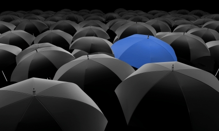 black and white: blue umbrella among black umbrellas