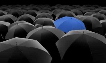 blue umbrella among black umbrellas