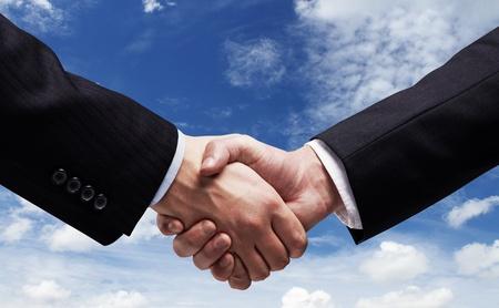 business handshake: handshake on  background of sky Stock Photo
