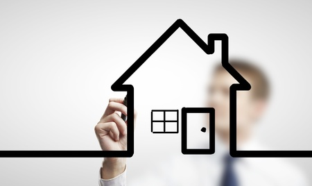 man drawing abstract house on a white background photo
