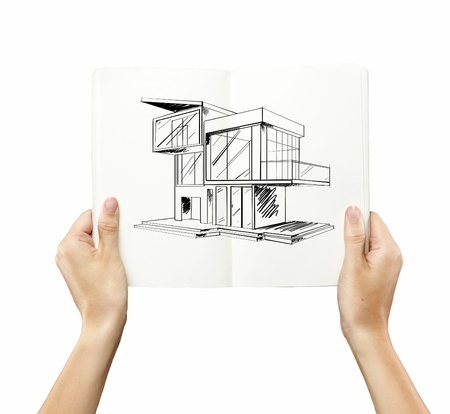 drawing cottage in book on a white background photo