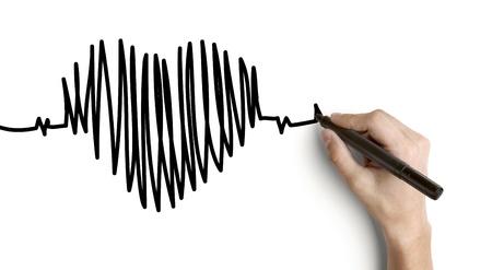 elettrocardiogramma: mano battito cardiaco disegno su uno sfondo bianco Archivio Fotografico