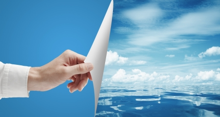 hand turn page to still sea surface Stock Photo - 14924512