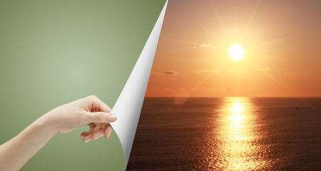 turn over: hand turn green page to sunset over ocean