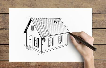 Hand drawing  house on  piece of paper photo